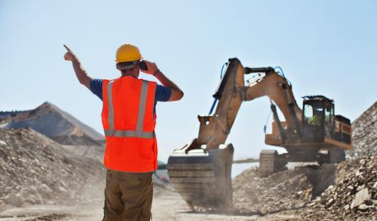 Constructive worker on mining site giving directions