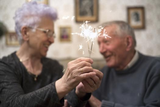 elderly couple with sparkler