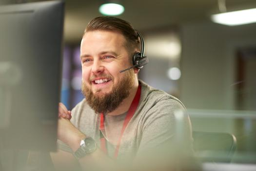 Bearded man using computer