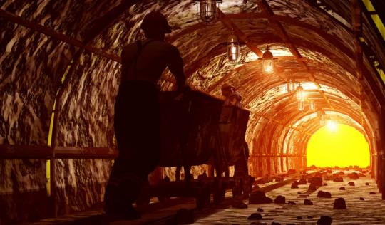 Man pushing trolley through mining tunnel