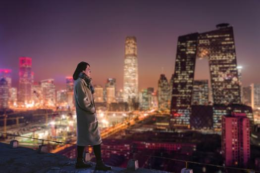 Woman standing in front of a cityscape